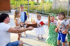 Leisure of preschool children. Animators at a children's party. Acting and developing games for children. Stock Photography