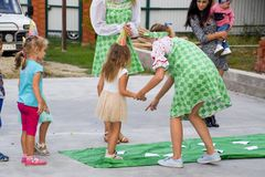Leisure of preschool children. Animators at a children's party. Acting and developing games for children. Village Poltavskaja, Russia - September 8, 2017 Stock Photo