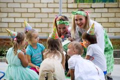 Leisure of preschool children. Animators at a children's party. Acting and developing games for children. Royalty Free Stock Photos