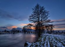 The village pond. Ending the day with a frozen pond Royalty Free Stock Photography