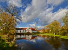 Village pond. Sunday afternoon at the picturesque village pond Royalty Free Stock Image