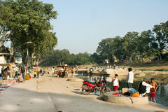 Village poor men have rest near the river bank Royalty Free Stock Photo
