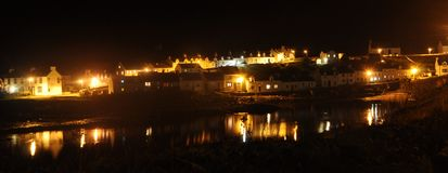 Islay Portnahaven at night. The village of Portnahaven. On the Scottish Island the Isle of Islay. View across the harbour at night stock images