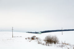 Village and power line in snow Stock Image