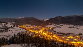 Picturesque village between mountains at night. In the village of pulsating life at night is based on the stars 4K Time Lapse stock footage