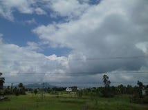 Village in rain season sky . Village, cloud,tree,house,grass in rain season Stock Image