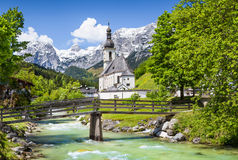Village of Ramsau in the Alps, Bavaria, Germany. Scenic mountain landscape in the Bavarian Alps with famous Parish Church of St. Sebastian in the village of Stock Photo
