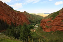 A village among the red rocks. Of Kirgistan Royalty Free Stock Photo
