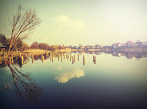 Village reflected in water retro vintage Instagram filter effect Royalty Free Stock Images