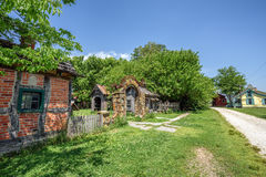 Village of relocated and restored buildings and other artifacts. CARTHAGE, MISSOURI, USA - MAY 11, 2016 : Cackleberry Arch Park - Red Oaks II, a village of Stock Photography