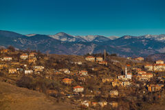 Village in the Rhodope Mountains. A small and peaceful village illuminated by sunlight Royalty Free Stock Image