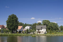 Village on river bank Royalty Free Stock Images