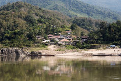 A village on the river bank. A village on the Mekong river bank in Lao Royalty Free Stock Photo