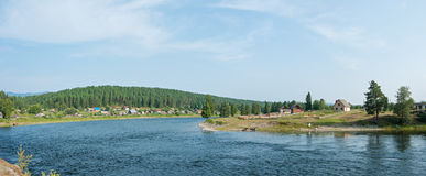 The village on the river Biya, panorama. Trekking in the Altai Mountains Stock Photos