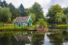 Village river with boat, Holland Stock Images