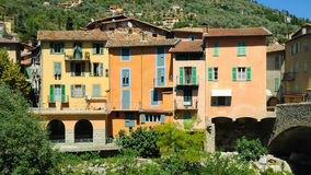 Village on a river no.1. Three colorful historic houses on the banks of a river in the Italian mountains Stock Image