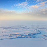 Village beside the river in polar terrain, top view Royalty Free Stock Images