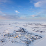 Village beside the river in polar terrain, top view Royalty Free Stock Photography