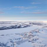 Village beside the river in polar terrain, top view Stock Image