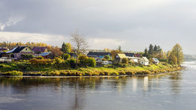The village on the river side in autumn Stock Photos