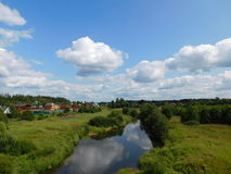 A village by the river. Stock Photo