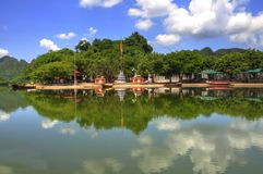 Village by the river (Vietnam). A small village beside a river in Vietnam Royalty Free Stock Images