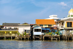 Village riverfront in Bangkok Thailand. Old Chao Phraya River Thai traditional houses, village riverfront in Bangkok Thailand Stock Photo
