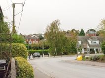 Village road leading forward with houses residential district stock photos
