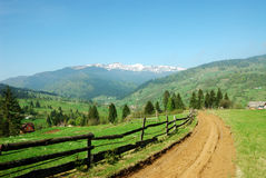 Village road in mountains. Village mud road in Carpathians Stock Photo
