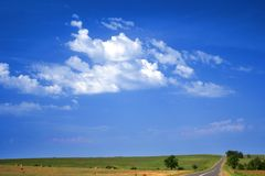 Village road takes to the sky Royalty Free Stock Images