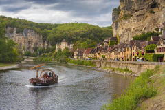 Village of Roc Gageac, Dordogne, France. With the local boats ferrying tourists to interesting view points Stock Photos