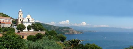 Village on the rocky coast of Corsica stock images