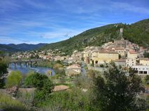 The village of Roquebrun sitting on the river Orb in the Haut La. Nguedoc, France stock photography
