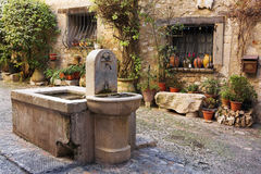 Village of Saint-Paul. Fresh water fountain in the centre of the quaint little French hilltop village of Saint-Paul de Vence, Southern France, Alpes Maritimes Royalty Free Stock Photography