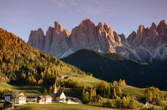 Village of Santa Magdalena in Val di Funes with the dolomitic group of the Odle on the background. Village of Santa Magdalena in Val di Funes with the dolomitic Stock Images