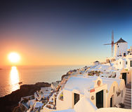 Village on Santorini island and a sunset Royalty Free Stock Photography