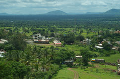 Village Satara locality and landscape. A beautiful scene of a houses in a village surrounded by a vibrant greenery and mountain backdrop Stock Images