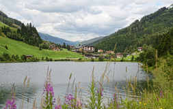 Village scape of Gerlos in Zillertal with small lake Stock Photo