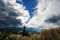 Village scene with dramatic sky Stock Photos