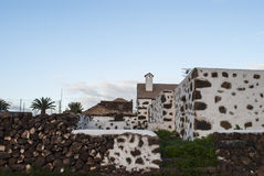 Village. Scene - typical canarian architecture - hill - sky - Fuerteventura, Canary Islands, Spain Royalty Free Stock Photo