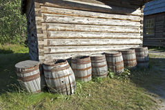 Village scenery with log-cabin and barrels Stock Photo