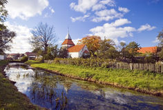 Village scenic, Poland. A small, typical village of Poland, village church and a small river royalty free stock photos