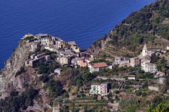 Village at sea coast. Aerial view of Corniglia village, Cinque Terre, Italy Stock Photo