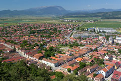 Village seen from above. View of Rasnov village, seen from the fortress with the Carpathian Mountains in the background Royalty Free Stock Images