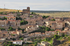 Hanging village of Sepulveda, Castile, Spain. Spanish traditional hanging village of Sepulveda and hilly countryside. Province of Segovia, Castile region, Spain Royalty Free Stock Photos