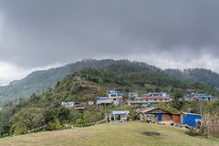 Village Settlement At The Top Of The Hill At Mardi Himal Trek Stock Image