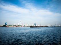 Village ship  and Cargo ship. Villageg ship and Cargo ship on Chao Phraya River in Bangkok, Thailand Royalty Free Stock Images