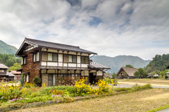 Village of Shirakawa Go, Japan. Traditional farm houses in village of Shirakawa Go, Japan under cloudy skies Stock Photos