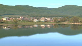 Village on the shores of Mirror Lake stock footage
