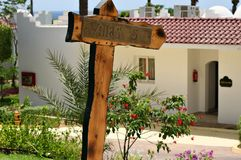 Index to the house by the sea. Village sign to the white house near the blue sea in summer heat Royalty Free Stock Photography
